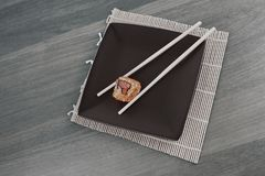 Close-up of sushi and chopsticks on a wooden table Stock Photography