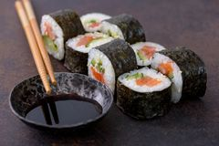 Close-up sushi roll with soy sauce Stock Photos