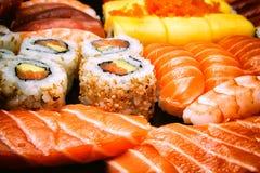 Close-up on sushi, sashimi and california rolls Stock Photography