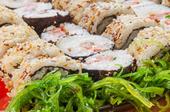Close-up of sushi with seaweed salad. Close-up of a wide selection of different sushi with a side of seaweed salad Stock Images