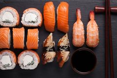 Close-up sushi Set sashimi with salmon, shrimp, eel and sushi rolls philadelphia served on stone slate. Top view Stock Photos