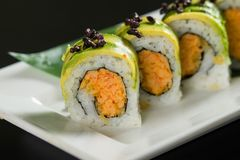 Sushi on a white plate. Close up of sushi on a white plate royalty free stock photos