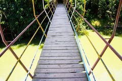 Suspension bridge across a river. Close up suspension bridge across a river Royalty Free Stock Images