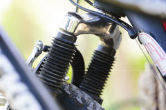 Close up on suspension element for bicycle. Close up on suspension fork element with brake and gear shifting cables for bicycle Royalty Free Stock Photos
