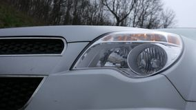 Close up of an SUV with four way flashes blinking on headlights stock video footage