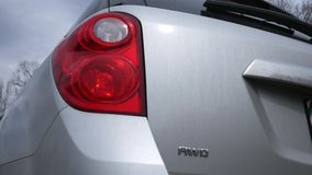 Close up of an SUV with four way flashes blinking on taillights stock video footage