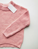 Close up of sweater or pullover with price tag Stock Photography