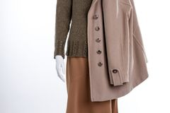 Close up sweater, skirt and coat. Cashmere overcoat for women. Feminine casual wear Royalty Free Stock Photography