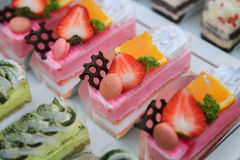 Close-up sweet cake set on wooden table Stock Photos