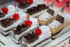 Close-up sweet cake set on wooden table Stock Photo