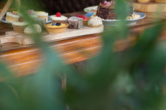 Close up of sweet food arranged on wooden table. At cafe shop Stock Image