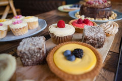 Close up of sweet food served in plate on wooden table Royalty Free Stock Photo