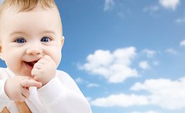 Close up of sweet little baby over sky background stock images