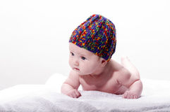 Close-up of sweet little newborn baby face with stocking cap Royalty Free Stock Photo