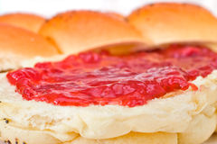 Close up of a sweet roll with strawberry jam Stock Image