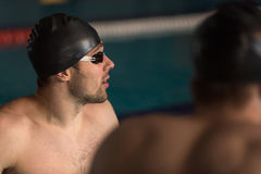 Close up of a swimmer in cap and swimming goggles Royalty Free Stock Photos