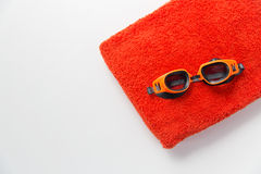 Close up of swimming goggles and towel Stock Photo