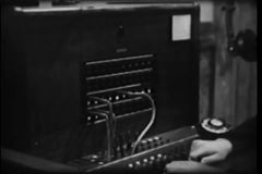 Close-up of switchboard operator connecting call