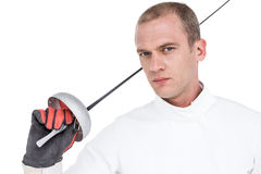 Close-up of swordsman holding fencing sword. Portrait of swordsman holding fencing sword on white background Stock Photography