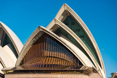 Close up of Sydney Opera House roof windows. Sydney, Australia - July 23, 2016: Close up of Sydney Opera House roof windows against blue sky on the background Royalty Free Stock Images