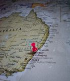 Close up of Sydney pin pointed on the world map with a pink pushpin royalty free stock photo
