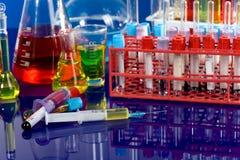 Close up of syringe with test tube Stock Photo