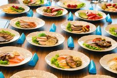 Airplane food presentation with variety of in flight meals. Close up table with plates of different airplane meals variants at presentation royalty free stock images