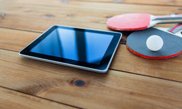 Close up of table tennis rackets and tablet pc Stock Photos