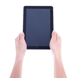 Close up of tablet pc with blank screen in male hands isolated o Stock Photo