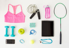 Close up of tablet pc, cellphone and sports stuff Stock Images