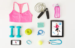 Close up of tablet pc, cellphone and sports stuff Stock Photo