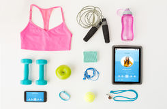 Close up of tablet pc, cellphone and sports stuff Stock Photos