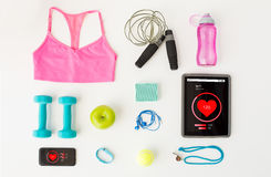 Close up of tablet pc, cellphone and sports stuff Stock Image