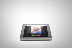 Close up of tablet pc computer with incoming call Stock Photo