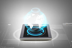 Close up of tablet pc with earth globe hologram Stock Images