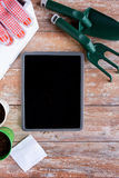 Close up of tablet pc and garden tools on table Stock Photos