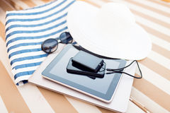 Close up of tablet pc and smartphone on beach Stock Photography