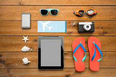 Close up of tablet pc and travel stuff Stock Photography