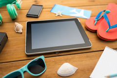 Close up of tablet pc and travel stuff Stock Photo