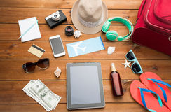 Close up of tablet pc and travel stuff Stock Photos
