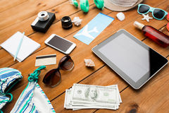 Close up of tablet pc and travel stuff Royalty Free Stock Images