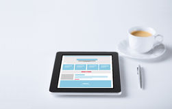 Close up of tablet pc with web design template Royalty Free Stock Photos