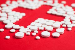 Close up of tablets placed in the shape of cross Stock Photo