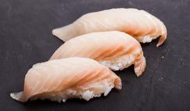 Tai nigiri sushi. Close-up of Tai nigiri sushi on a black slate background Royalty Free Stock Photography