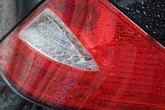 Close-up of tail light of car for sale in showroom Royalty Free Stock Photos
