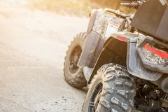 Close-up tail view of ATV quad bike. Dirty whell of AWD all-terrain vehicle. Travel and adventure concept.Copyspace.Toned.  Royalty Free Stock Images