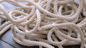 Close-up of a tangled rope spinning. stock video