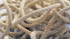 Close-up of a tangled rope spinning. stock video footage