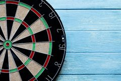 Close up target dart board center point on the table. Head to target marketing and business concept Royalty Free Stock Photo