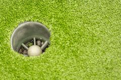 Submerged ball in golf lies in the hole on the green stock photos